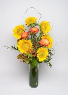 Sunflowers and roses in tall cylinder